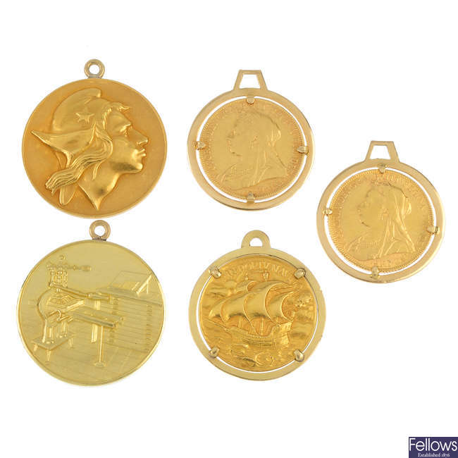 A selection of five coins and medallions.