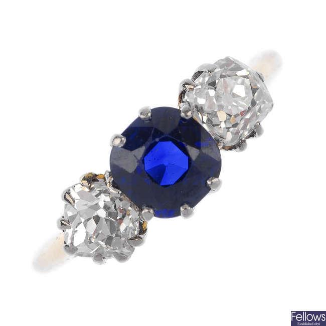 An Edwardian 18ct gold sapphire and diamond three-stone ring.