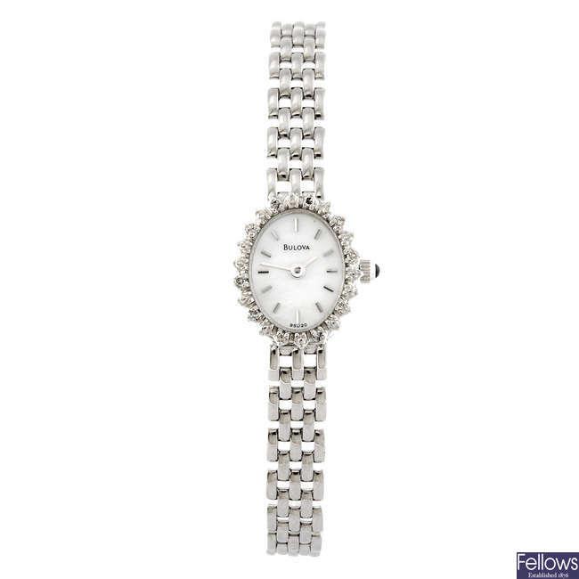 BULOVA - a lady's white metal bracelet watch.