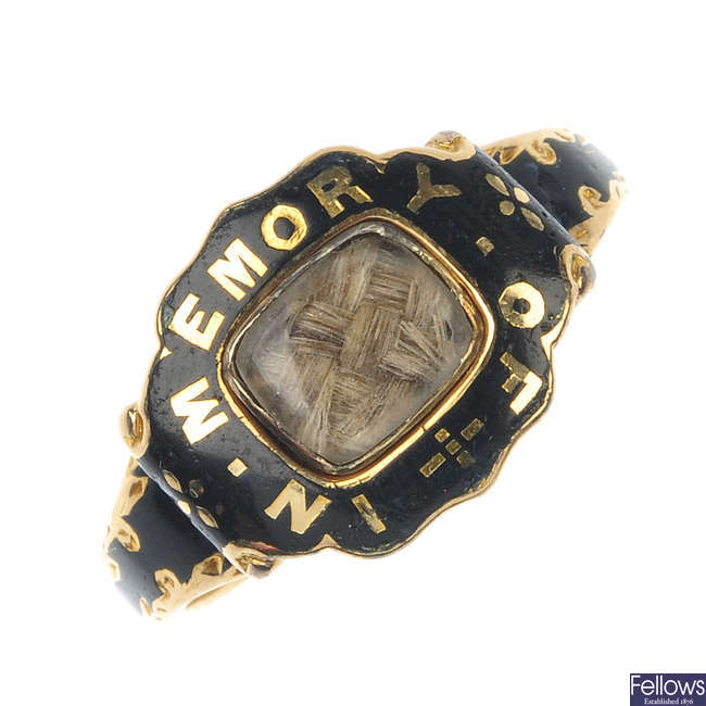 An early Victorian 18ct gold enamel and hair memorial ring.
