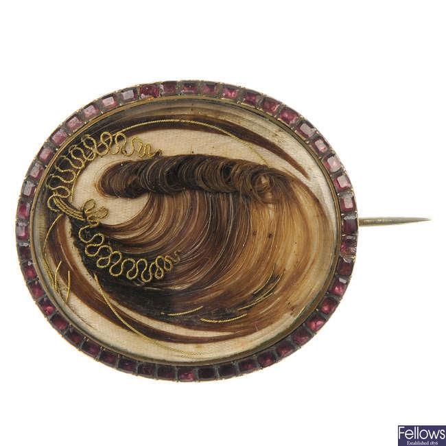 An early 19th century garnet and hair brooch.
