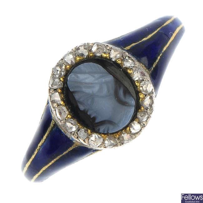 A diamond cameo and enamel memorial ring.