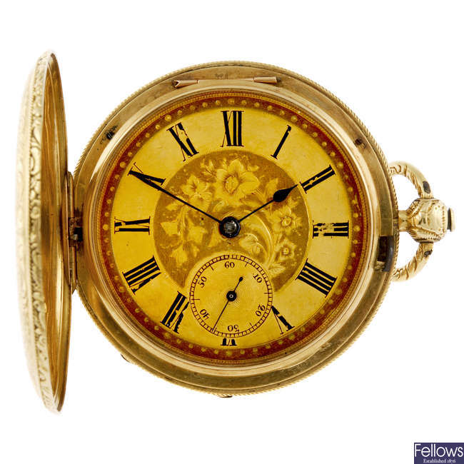 A yellow metal full hunter pocket watch.