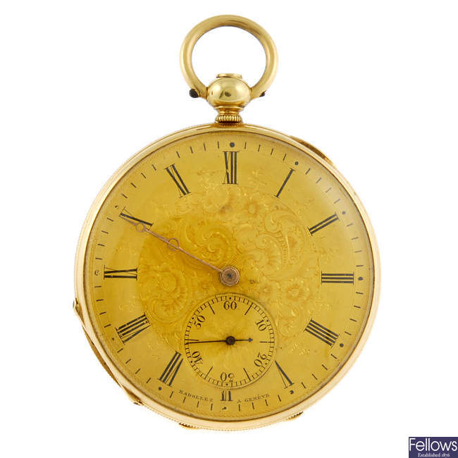 A yellow metal open face fob watch.