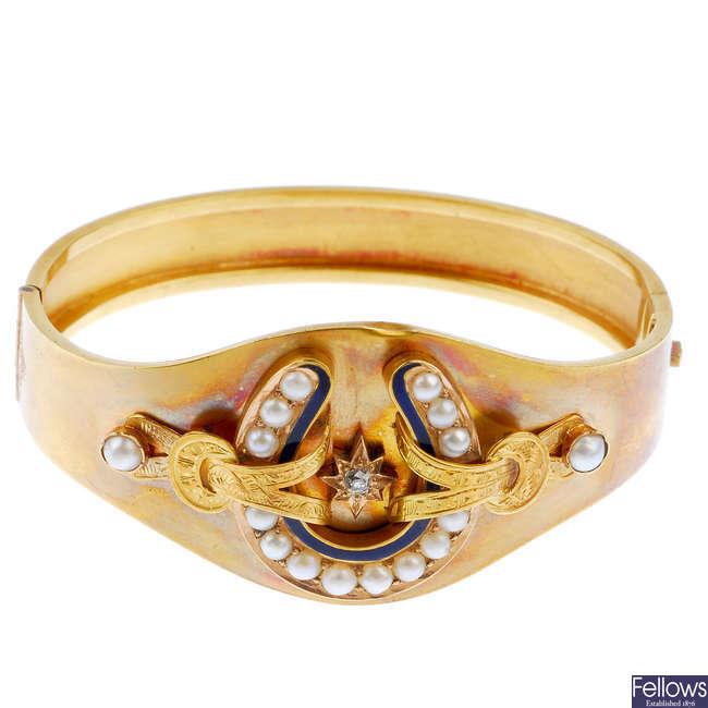 A late Victorian gold diamond split pearl and enamel hinged bangle, circa 1880.