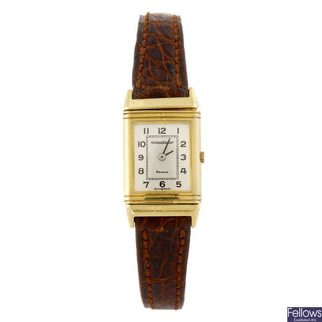 JAEGER-LECOULTRE - a lady's 18ct gold Reverso wrist watch.