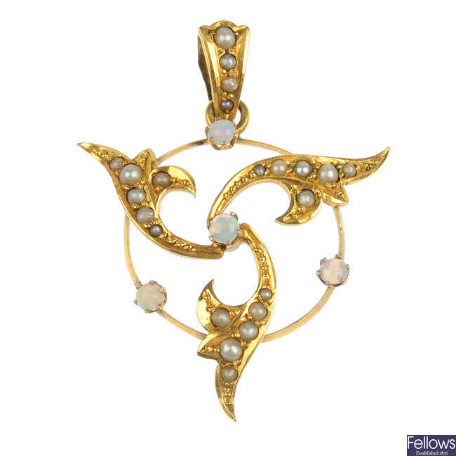 An early 20th century 9ct gold opal and seed pearl pendant.