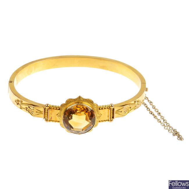 A late 19th century 18ct gold citrine hinged bangle.