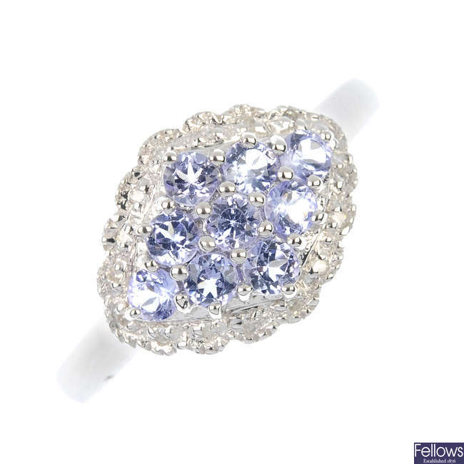 A 9ct gold tanzanite and diamond cluster ring.
