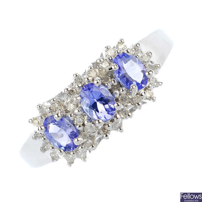 A 9ct gold tanzanite and diamond triple cluster ring.