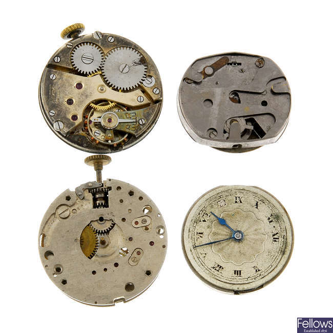 Group of assorted watch movements and parts.