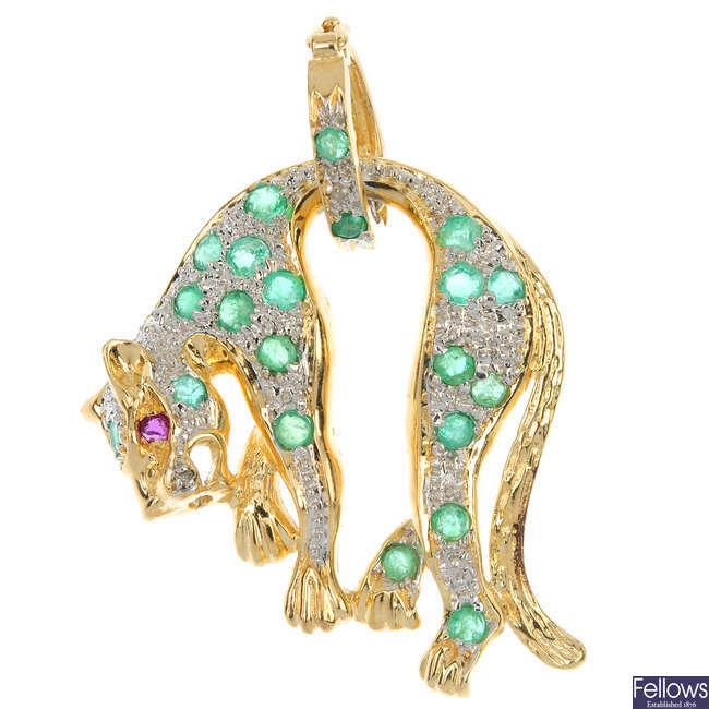 A diamond and emerald leopard pendant.