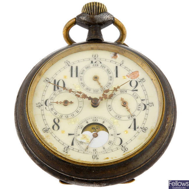 A base metal open face triple calendar pocket watch.