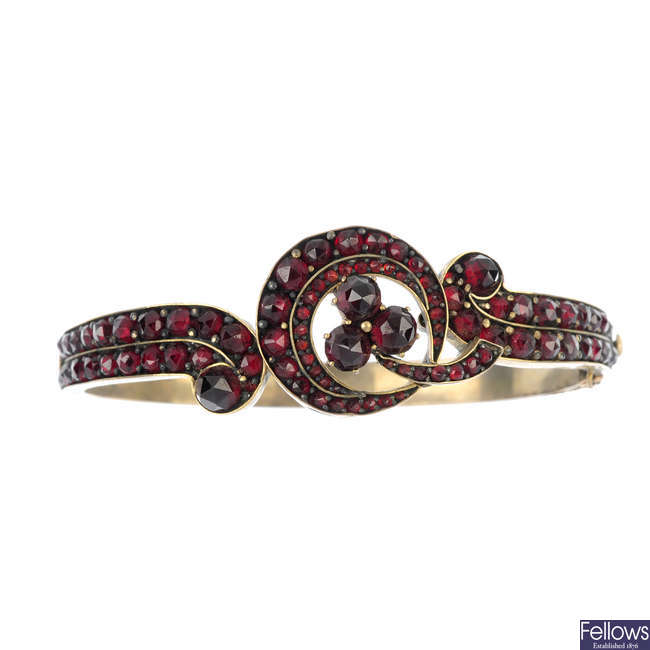 A late 19th century garnet and red paste bangle and bracelet.