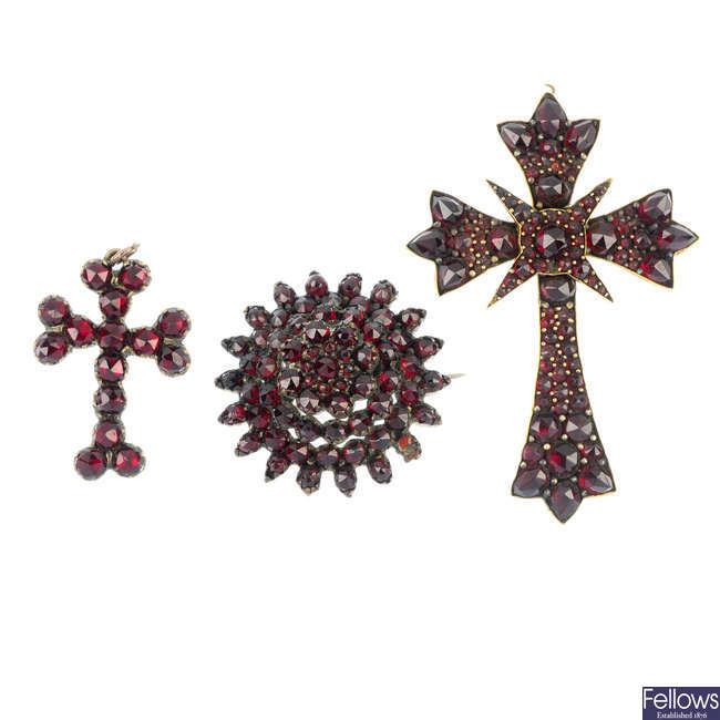 Two garnet and red paste pendants and a brooch.