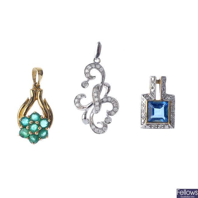 A selection of five gem-set pendants.