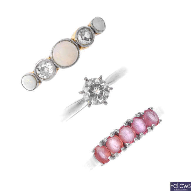 A selection of three gem-set and diamond rings.