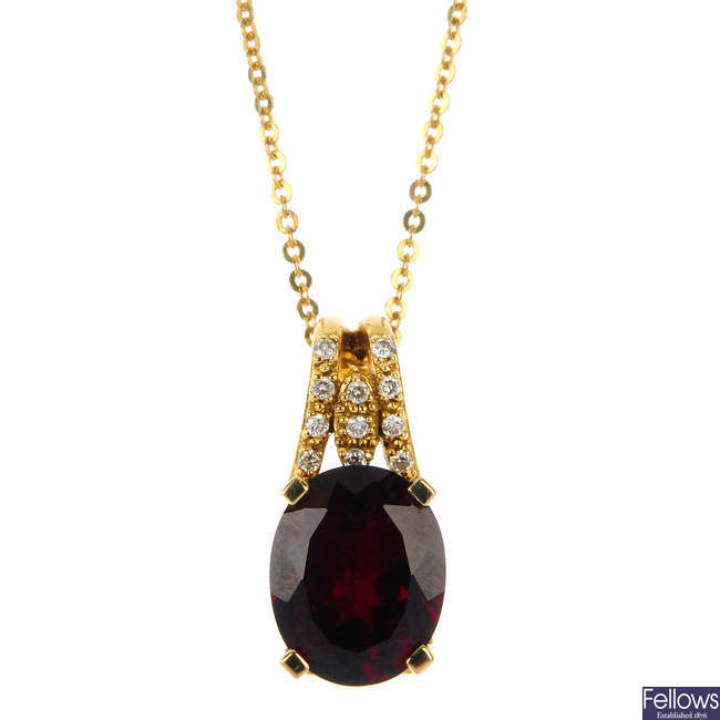 A garnet and diamond pendant.