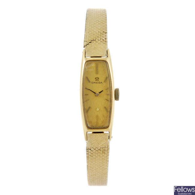 OMEGA - a lady's yellow metal bracelet watch.