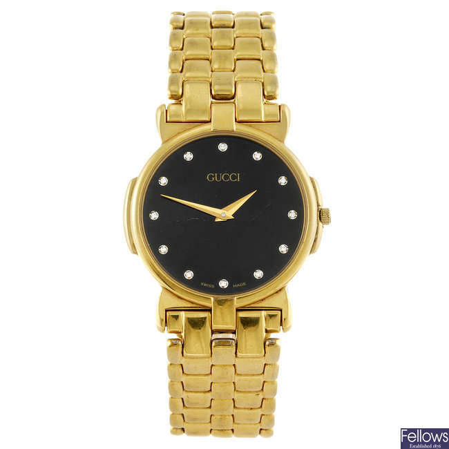 GUCCI - a mid-size gold plated 3400M bracelet watch.