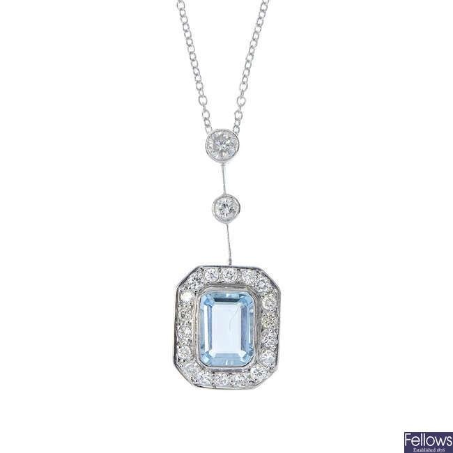 An aquamarine and diamond pendant.