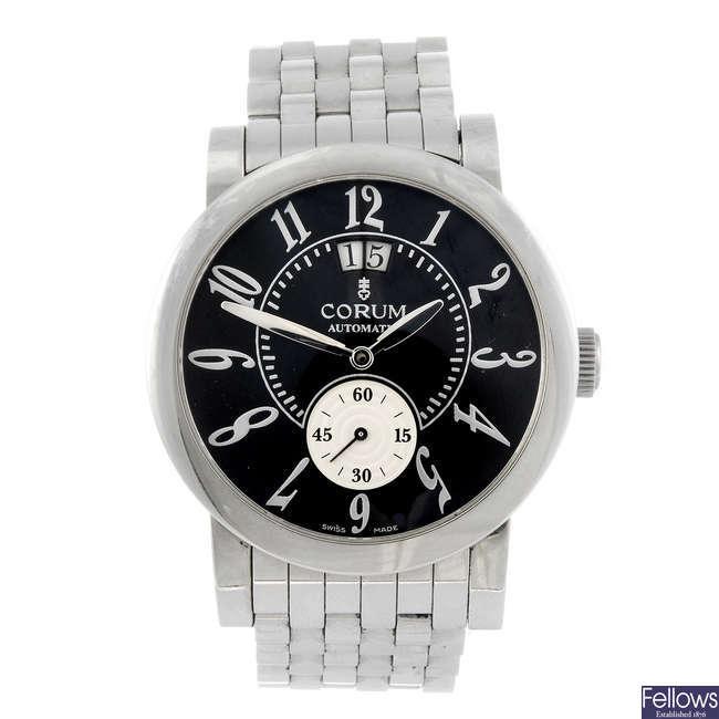 CORUM - a gentleman's Classical Grande Date bracelet watch.