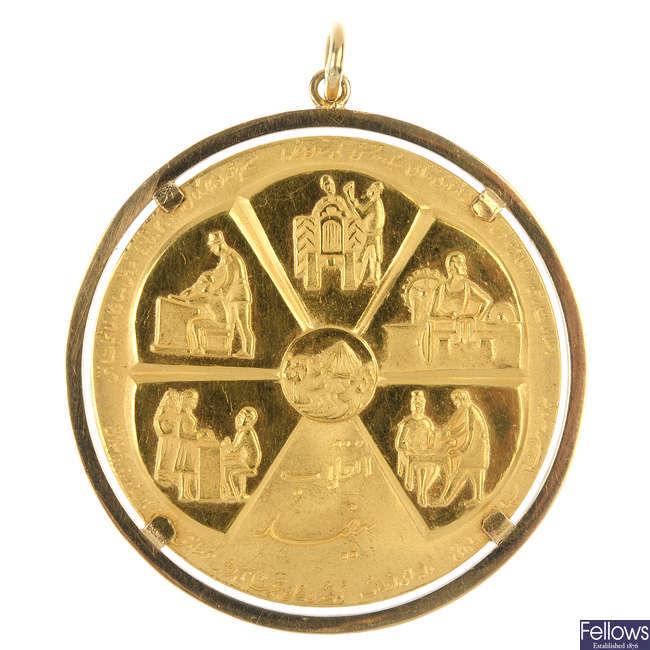 A medallion pendant.