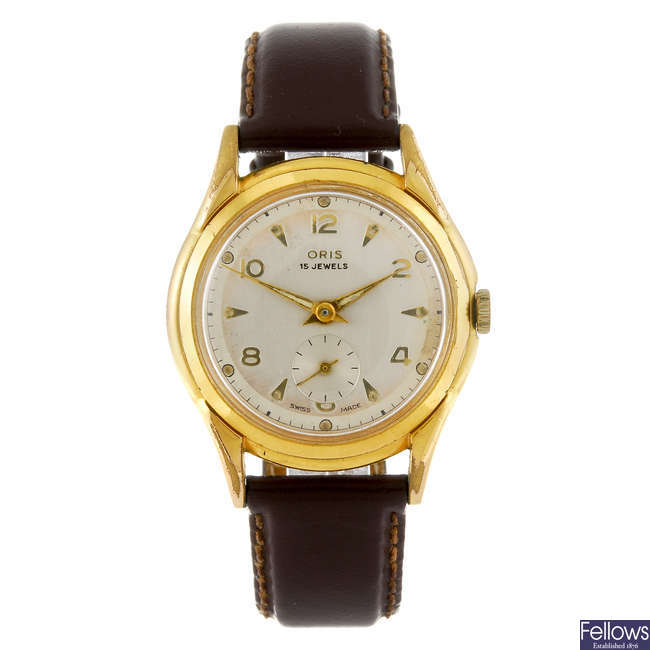 ORIS - a gentleman's gold plated wrist watch with a Hilton wrist watch.