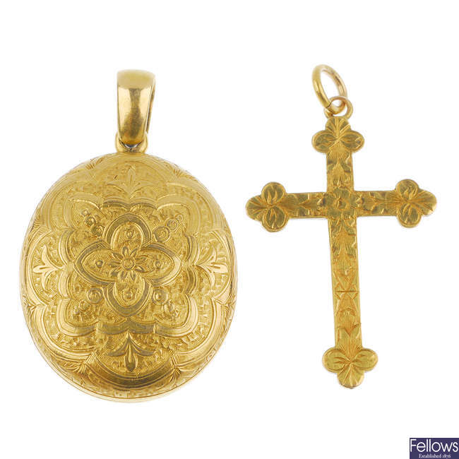 An early 20th century 15ct gold cross pendant and a gold locket.