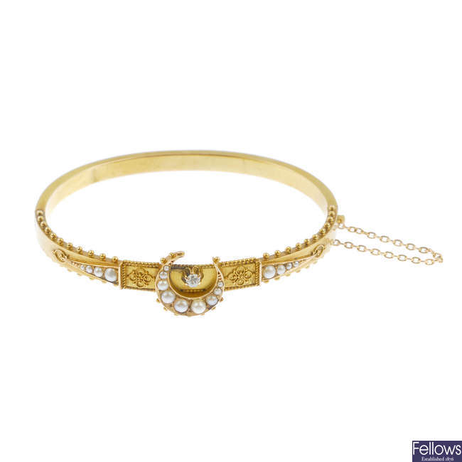 A late Victorian 15ct gold diamond and split pearl hinged bangle.