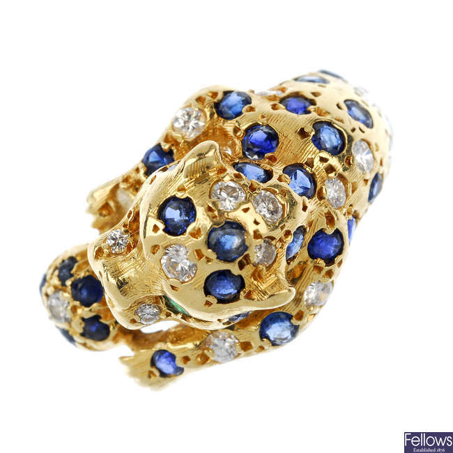 An 18ct gold, diamond and sapphire leopard ring.