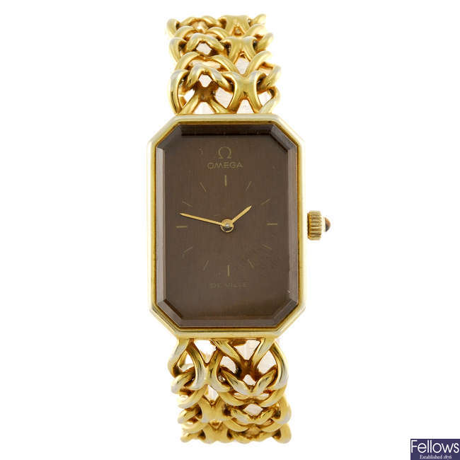 OMEGA - a lady's gold plated silver De Ville bracelet watch.