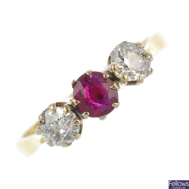 A mid 20th century 18ct gold diamond and ruby three-stone ring.