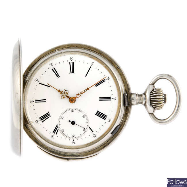 A white metal repeater pocket watch.