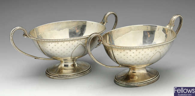 A pair of George III provincial silver tureens.