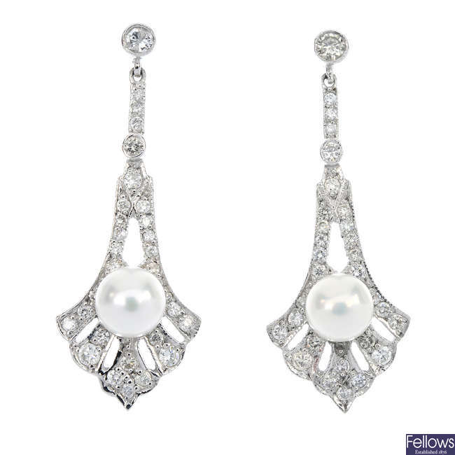 A pair of diamond and cultured pearl ear pendants.