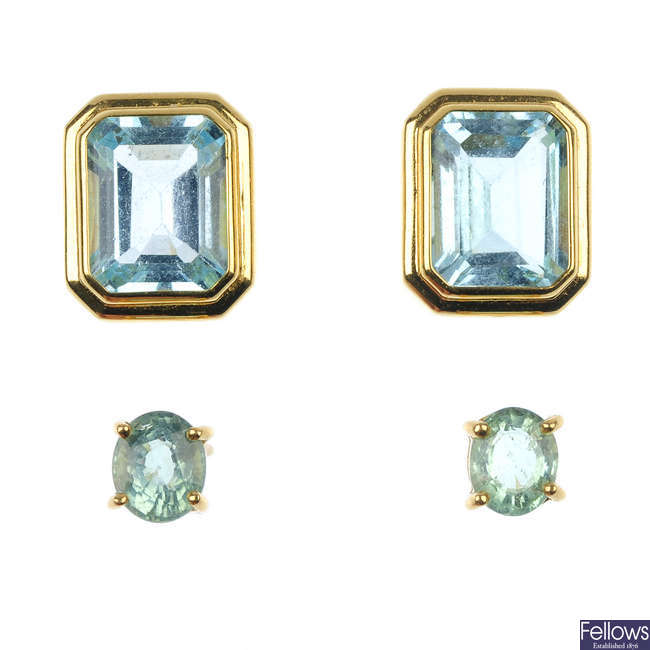 Two pairs of 18ct gold gem-set ear studs.