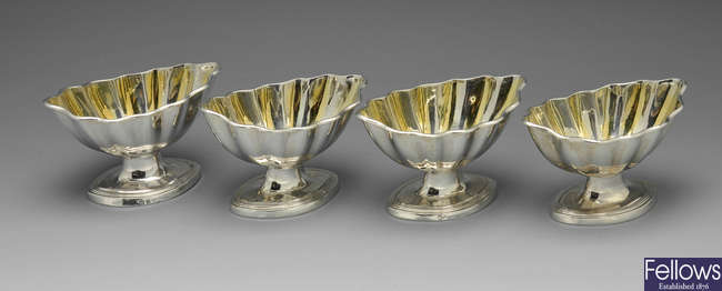 A set of four George III silver salts.