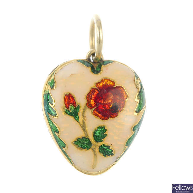 A mid 19th century 12ct gold enamel heart-shape pendant.