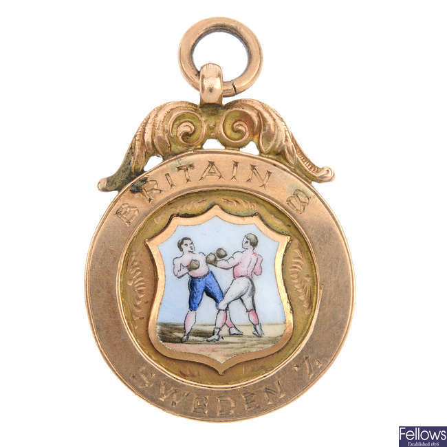 A mid 20th century 9ct gold boxing commemorative medallion.