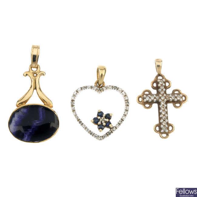 A selection of eleven gem-set pendants.
