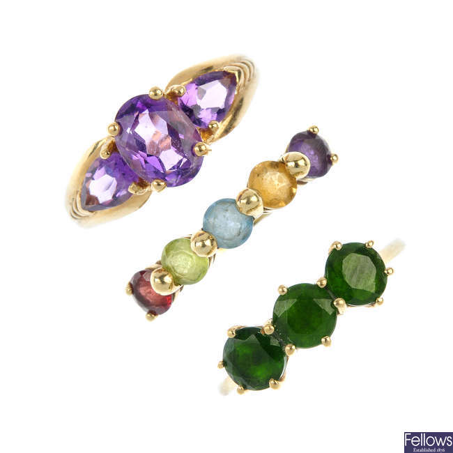 A selection of four gem-set rings.