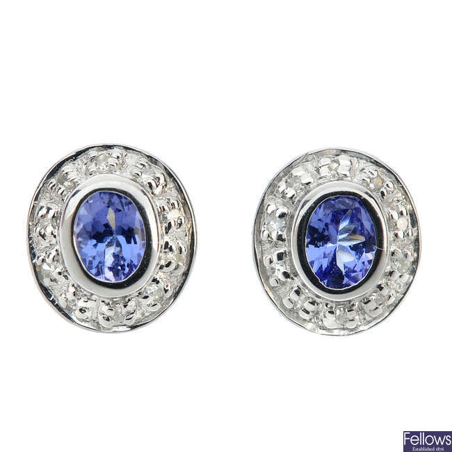 A pair of tanzanite and diamond cluster ear studs.