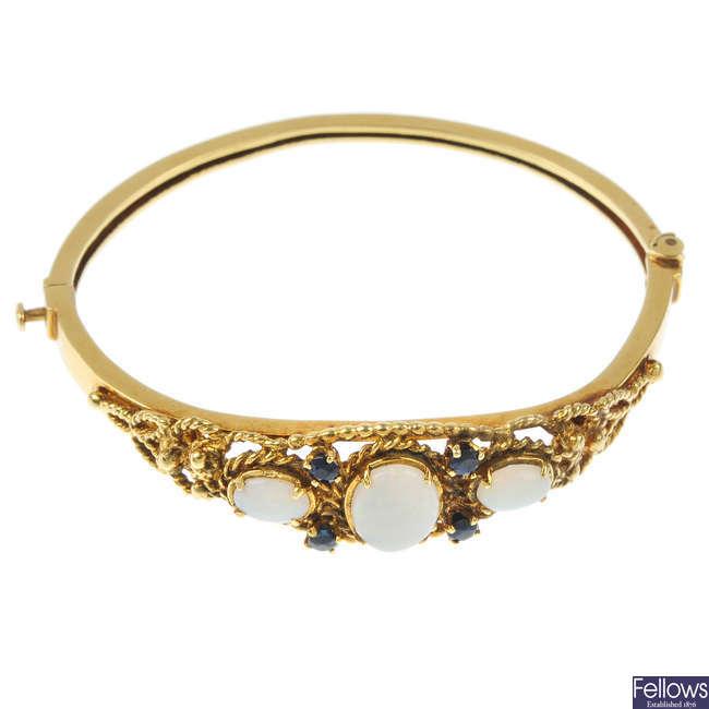 An opal and sapphire hinged bangle.