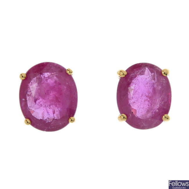 A pair of 18ct gold oval-shape glass-filled ruby ear studs.