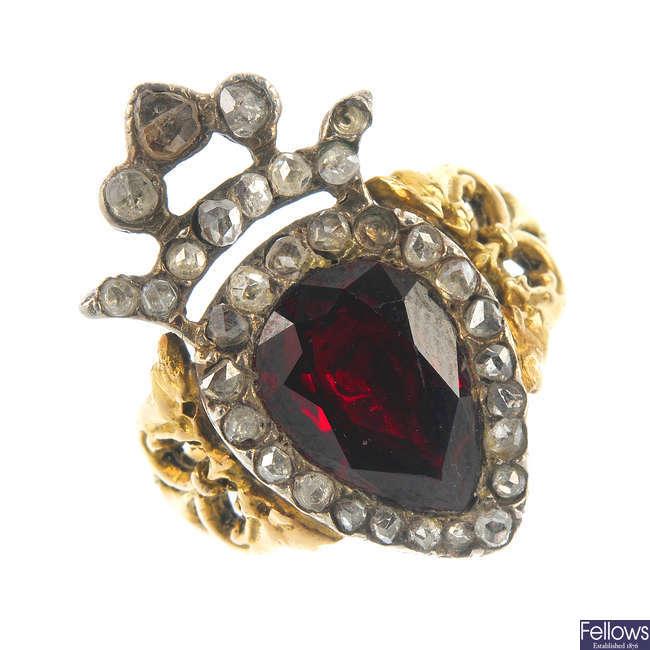 A garnet and diamond dress ring.