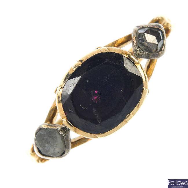 A garnet and diamond ring.