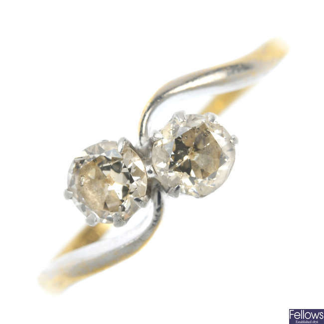 A mid 20th century 18ct gold and platinum diamond two-stone ring