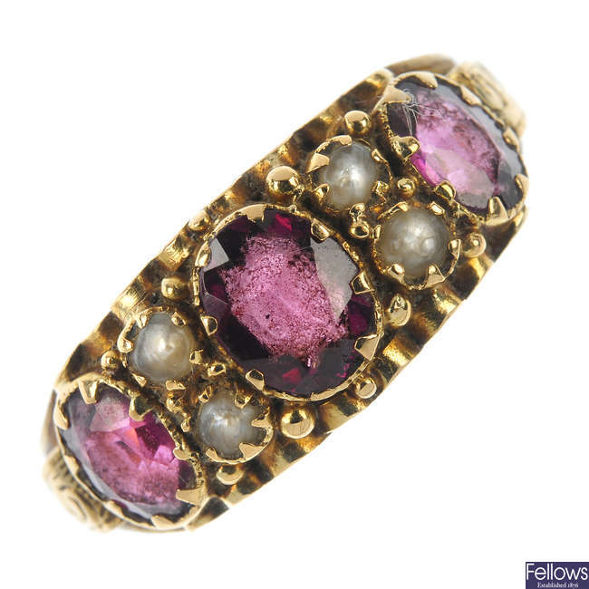 A late Victorian 18ct gold garnet and split pearl ring.