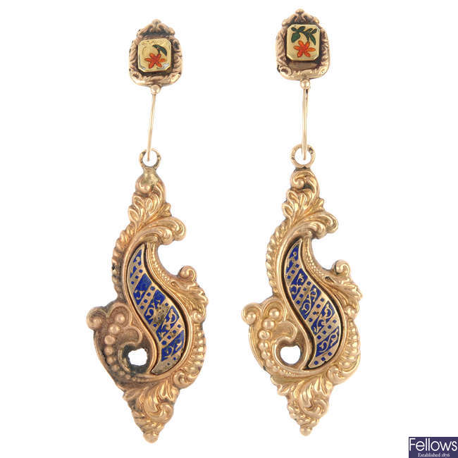 A pair of enamel ear pendants.
